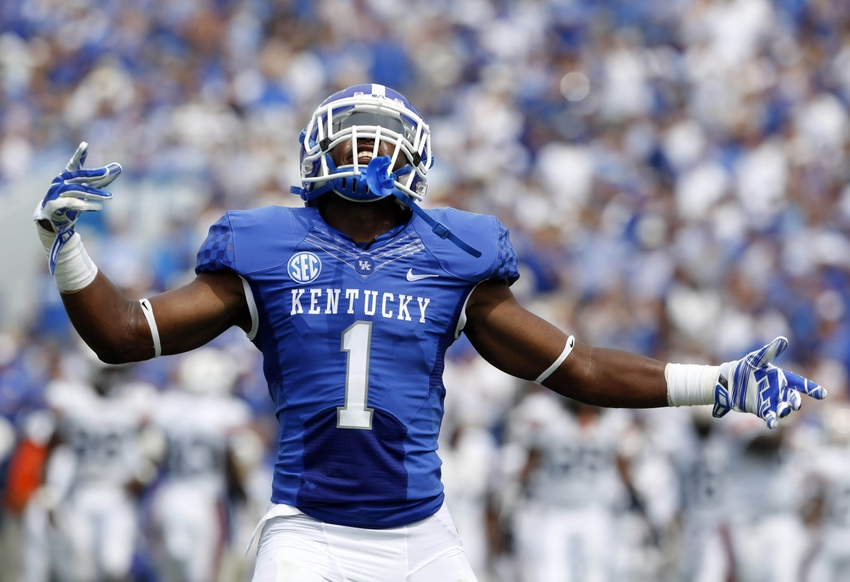 Aug 30, 2014; Lexington, KY, USA; Kentucky Wildcats safety A.J. Stamps (1) celebrates after intercepting the ball against the UT Martin Skyhawks in the first half at Commonwealth Stadium. Mandatory Credit: Mark Zerof-USA TODAY Sports