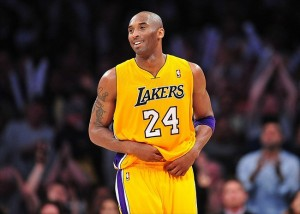 April 3, 2012; Los Angeles, CA, USA; Los Angeles Lakers shooting guard Kobe Bryant (24) reacts after scoring a basket against the New Jersey Nets during the second half at Staples Center. Mandatory Credit: Gary A. Vasquez-USA TODAY Sports