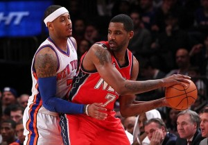 Feb 4, 2012; New York, NY, USA; New Jersey Nets forward Shawne Williams (7) looks to pass the ball against New York Knicks forward Carmelo Anthony (7) during the second half at Madison Square Garden. Knicks beat the Nets 99-92. Mandatory Credit: Nicole Sweet-USA TODAY Sports