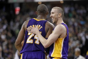Mar 30, 2013; Sacramento, CA, USA; Los Angeles Lakers guard Steve Blake (5) pats guard Kobe Bryant (24) on the back after Bryant was fouled against the Sacramento Kings late in the fourth quarter at Sleep Train Arena. The Lakers defeated the Kings 103-98. Mandatory Credit: Cary Edmondson-USA TODAY Sports