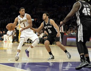 Apr 28, 2013; Los Angeles, CA, USA; Los Angeles Lakers point guard Darius Morris (1) drives to the basket against San Antonio Spurs point guard Cory Joseph (5) in game four of the first round of the 2013 NBA playoffs at the Staples Center. Mandatory Credit: Richard Mackson-USA TODAY Sports