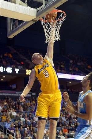 Oct 8, 2013; Ontario, CA, USA; Los Angeles Lakers center Chris Kaman (9) dunks the ball against the Denver Nuggets at Citizens Business Bank Arena. Mandatory Credit: Kirby Lee-USA TODAY Sports