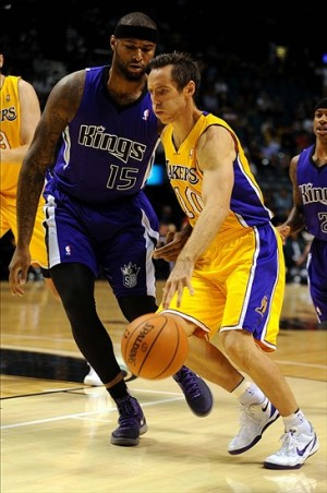 Oct 10, 2013; Las Vegas, NV, USA; Los Angeles Lakers guard Steve Nash (10) dribbles the ball against the defense of Sacramento Kings center DeMarcus Cousins (15) during the first quarter of an NBA preseason game at MGM Grand Arena. Mandatory Credit: Stephen R. Sylvanie-USA TODAY Sports