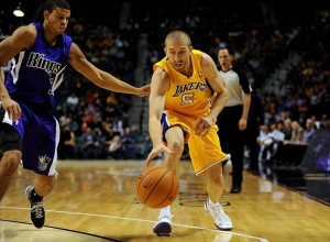Oct 10, 2013; Las Vegas, NV, USA; Los Angeles Lakers guard Steve Blake (5) attempts to control a loose ball while being defended by Sacramento Kings guard Ray McCallum (3) during an NBA preseason game at MGM Grand Arena. Mandatory Credit: Stephen R. Sylvanie-USA TODAY Sports