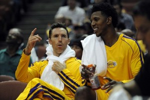 Oct 25, 2013; Anaheim, CA, USA; Los Angeles Lakers guard Nick Young (right) and guard Steve Nash (left) talk on the bench during the game against the Utah Jazz during the fourth quarter at Honda Center. The Los Angeles Lakers defeated the Utah Jazz 111-106. Mandatory Credit: Kelvin Kuo-USA TODAY Sports