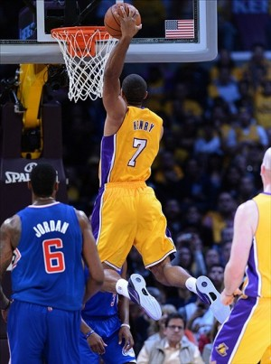 Oct 29, 2013; Los Angeles, CA, USA; Los Angeles Clippers center DeAndre Jordan (6) looks on as Los Angeles Lakers shooting guard Xavier Henry (7) dunks the ball in the first half of the game at the at Staples Center. Mandatory Credit: Jayne Kamin-Oncea-USA TODAY Sports