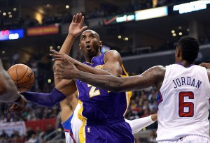 Apr 7, 2013; Los Angeles, CA, USA; Los Angeles Clippers center DeAndre Jordan (6) defends Los Angeles Lakers shooting guard Kobe Bryant (24) in the first half at the Staples Center. Mandatory Credit: Jayne Kamin-Oncea-USA TODAY Sports