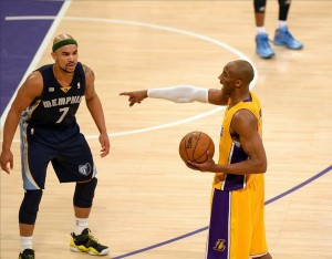 Apr 5, 2013; Los Angeles, CA, USA; Los Angeles Lakers shooting guard Kobe Bryant (24) gestures as Memphis Grizzlies point guard Jerryd Bayless (7) defends during the second quarter at the Staples Center. Mandatory Credit: Jake Roth-USA TODAY Sports