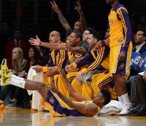 Oct 29, 2013; Los Angeles, CA, USA; Los Angeles Lakers shooting guard Nick Young (0) is charged with an offensive foul as the bench reacts in the first half of the game against the Los Angeles Clippers at the at Staples Center. Mandatory Credit: Jayne Kamin-Oncea-USA TODAY Sports