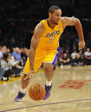 November 1, 2013; Los Angeles, CA, USA; Los Angeles Lakers shooting guard Xavier Henry (7) moves the ball against the San Antonio Spurs during the first half at Staples Center. Mandatory Credit: Gary A. Vasquez-USA TODAY Sports