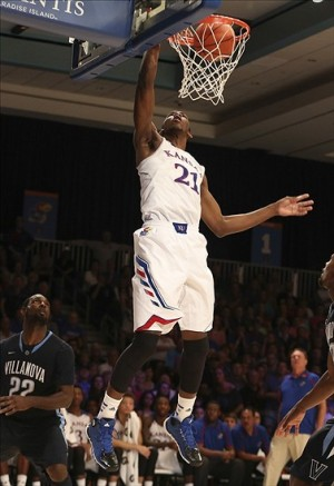 Nov 29, 2013; Paradise Island, BAHAMAS; Kansas Jayhawks center Joel Embiid (21) dunks during the game against the Villanova Wildcats at the 2013 Battle 4 Atlantis in the Imperial Arena at the Atlantis Resort. Villanova won 63-59. Mandatory Credit: Kevin Jairaj-USA TODAY Sports