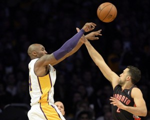 Dec 8, 2013; Los Angeles, CA, USA; Los Angeles Lakers shooting guard Kobe Bryant (24) shoots over Toronto Raptors small forward Landry Fields (2) during the first half at Staples Center. Mandatory Credit: Richard Mackson-USA TODAY Sports