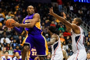 Dec 16, 2013; Atlanta, GA, USA; Los Angeles Lakers shooting guard Kobe Bryant (24) tries to keep the ball in bounds in the first quarter against the Atlanta Hawks at Philips Arena. Mandatory Credit: Daniel Shirey-USA TODAY Sports