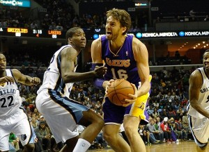 Dec 17, 2013; Memphis, TN, USA; Los Angeles Lakers center Pau Gasol (16) drives to the basket against Memphis Grizzlies power forward Ed Davis (32) during the fourth quarter at FedExForum. Los Angeles Lakers defeat the Memphis Grizzlies 96-92 Mandatory Credit: Justin Ford-USA TODAY Sports