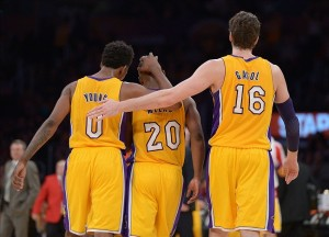 Jan 3, 2014; Los Angeles, CA, USA; Los Angeles Lakers guards Nick Young (0) and Jodie Meeks (20) and forward Pau Gasol (16) embrace during the game against the Utah Jazz at Staples Center. Mandatory Credit: Kirby Lee-USA TODAY Sports