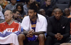 Jan 10, 2014; Los Angeles, CA, USA; Los Angeles Lakers players Chris Kaman (left), Jordan Hill (center) and Kobe Bryant react during the game against the Los Angeles Clippers at Staples Center. Mandatory Credit: Kirby Lee-USA TODAY Sports
