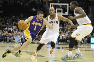 Feb 5, 2014; Cleveland, OH, USA; Los Angeles Lakers point guard Jordan Farmar (1) dribbles the ball around Cleveland Cavaliers point guard Jarrett Jack (center) and shooting guard Dion Waiters in the first quarter at Quicken Loans Arena. Mandatory Credit: David Richard-USA TODAY Sports