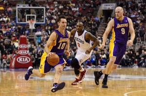 Feb 7, 2014; Philadelphia, PA, USA; Los Angeles Lakers guard Steve Nash (10) is defended by Philadelphia 76ers guard James Anderson (9) during the fourth quarter at the Wells Fargo Center. The Lakers defeated the Sixers 112-98. Mandatory Credit: Howard Smith-USA TODAY Sports