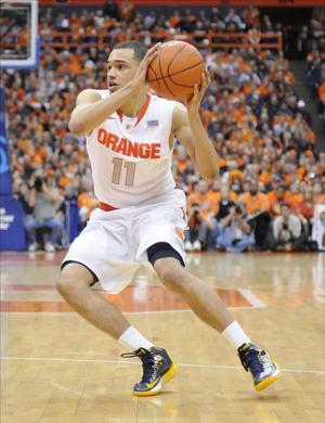 Feb 15, 2014; Syracuse, NY, USA; Syracuse Orange guard Tyler Ennis (11) handles the ball during the second half of a game against the North Carolina State Wolfpack at the Carrier Dome. Syracuse won the game 56-55. Mandatory Credit: Mark Konezny-USA TODAY Sports
