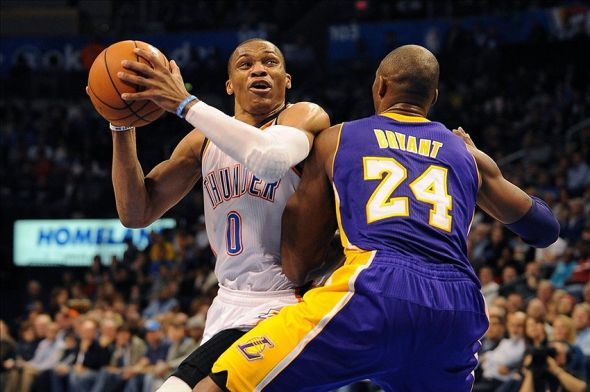 Mar 5, 2013; Oklahoma City, OK, USA; Oklahoma City Thunder guard Russell Westbrook (0) handles the ball against Los Angeles Lakers guard Kobe Bryant (24) during the second half at Chesapeake Energy Arena. Mandatory Credit: Mark D. Smith-USA TODAY Sports