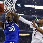 Apr 7, 2014; Arlington, TX, USA; Kentucky Wildcats forward Julius Randle (30) shoots against Connecticut Huskies forward DeAndre Daniels (2) in the second half during the championship game of the Final Four in the 2014 NCAA Mens Division I Championship tournament at AT&T Stadium. Mandatory Credit: Robert Deutsch-USA TODAY Sports