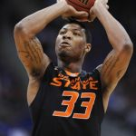 Mar 13, 2014; Kansas City, MO, USA; Oklahoma State Cowboys guard Marcus Smart (33) shoots a free throw during the first half against the Kansas Jayhawks in the second round of the Big 12 Conference college basketball tournament at Sprint Center. Mandatory Credit: Denny Medley-USA TODAY Sports