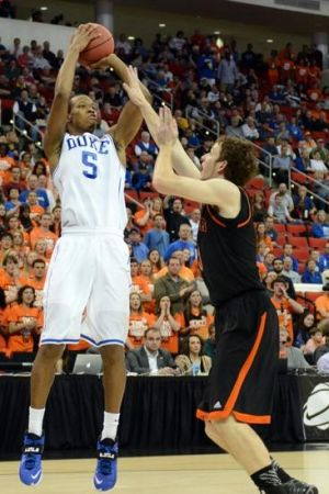 Mar 21, 2014; Raleigh, NC, USA; Duke Blue Devils forward Rodney Hood (5) shoots the ball against Mercer Bears forward Bud Thomas (5) in the first half of a men