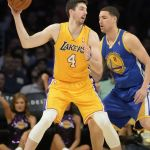Apr 11, 2014; Los Angeles, CA, USA; Los Angeles Lakers forward Ryan Kelly (4) goes up against the defense of Golden State Warriors guard Klay Thompson (11) at Staples Center. Mandatory Credit: Richard Mackson-USA TODAY Sports