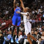Apr 6, 2013; Miami, FL, USA; Philadelphia 76ers shooting guard Justin Holiday (14) shoots over Miami Heat shooting guard Ray Allen (34) during the first half at the American Airlines Arena. Mandatory Credit: Steve Mitchell-USA TODAY Sports
