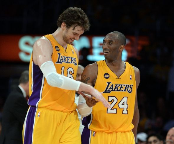 Apr 2, 2013; Los Angeles, CA, USA; Los Angeles Lakers shooting guard Kobe Bryant (24) smiles at power forward Pau Gasol (16) after he completed a triple double in the second half of the game against the Dallas Mavericks at the Staples Center. Lakers won 101-81. Mandatory Credit: Jayne Kamin-Oncea-USA TODAY Sports