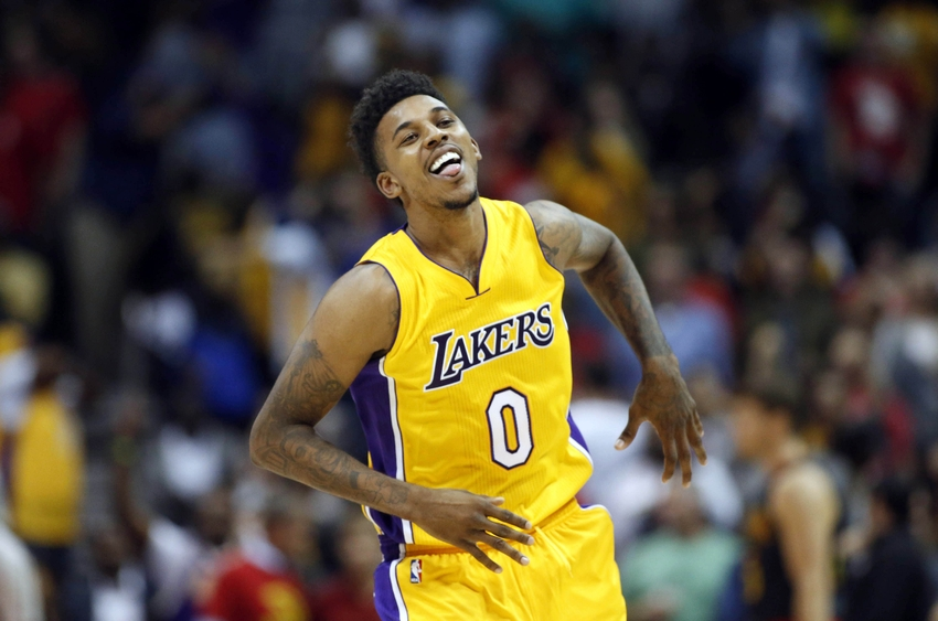 Nov 2, 2016; Atlanta, GA, USA; Los Angeles Lakers forward Nick Young (0) celebrates a basket in the fourth quarter of their game against the Atlanta Hawks at Philips Arena. The Lakers won 123-116. Mandatory Credit: Jason Getz-USA TODAY Sports