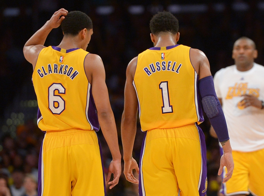 Mar 8, 2016; Los Angeles, CA, USA; Los Angeles Lakers guard Jordan Clarkson (6) and Lakers guard D'Angelo Russell (1) speak in the second half of the game against the Orlando Magic at Staples Center. The Lakers won 107-98. Mandatory Credit: Jayne Kamin-Oncea-USA TODAY Sports