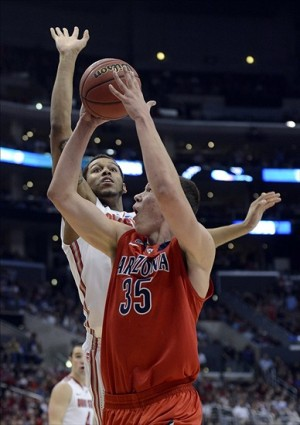 Mar 28, 2013; Los Angeles, CA, USA; Ohio State Buckeyes center Amir Williams (23) defends against Arizona Wildcats center Kaleb Tarczewski (35) during the first half of the semifinals of the West regional of the 2013 NCAA tournament at the Staples Center. Mandatory Credit: Richard Mackson-USA TODAY Sports