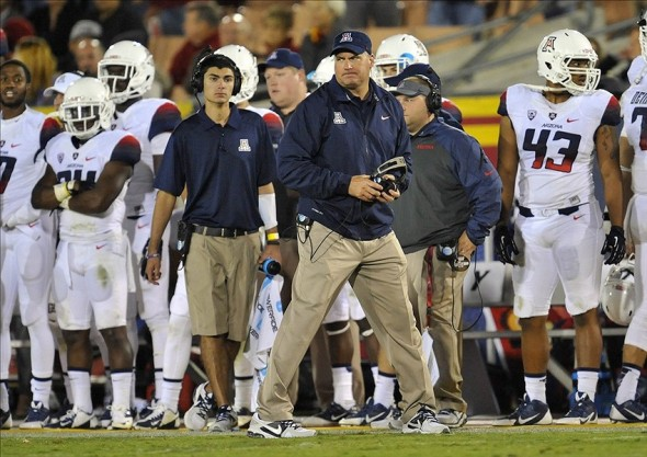October 10, 2013; Los Angeles, CA, USA; Arizona Wildcats head coach Rich Rodriguez watches game action against the Southern California Trojans during the second half at the Los Angeles Memorial Coliseum. Mandatory Credit: Gary A. Vasquez-USA TODAY Sports