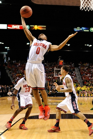March 14, 2015; Las Vegas, NV, USA; Arizona Wildcats guard Parker Jackson-Cartwright (0) grabs a rebound during the first half in the championship game of the Pac-12 Conference tournament against the Oregon Ducks at MGM Grand Garden Arena. The Wildcats defeated the Ducks 80-52. Mandatory Credit: Kyle Terada-USA TODAY Sports