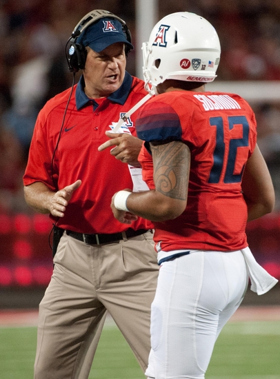 Sep 19, 2015; Tucson, AZ, USA; Arizona Wildcats head coach Rich Rodriguez talks to quarterback Anu Solomon (12) during the first quarter against the Northern Arizona Lumberjacks at Arizona Stadium. Arizona won 77-13. Mandatory Credit: Casey Sapio-USA TODAY Sports