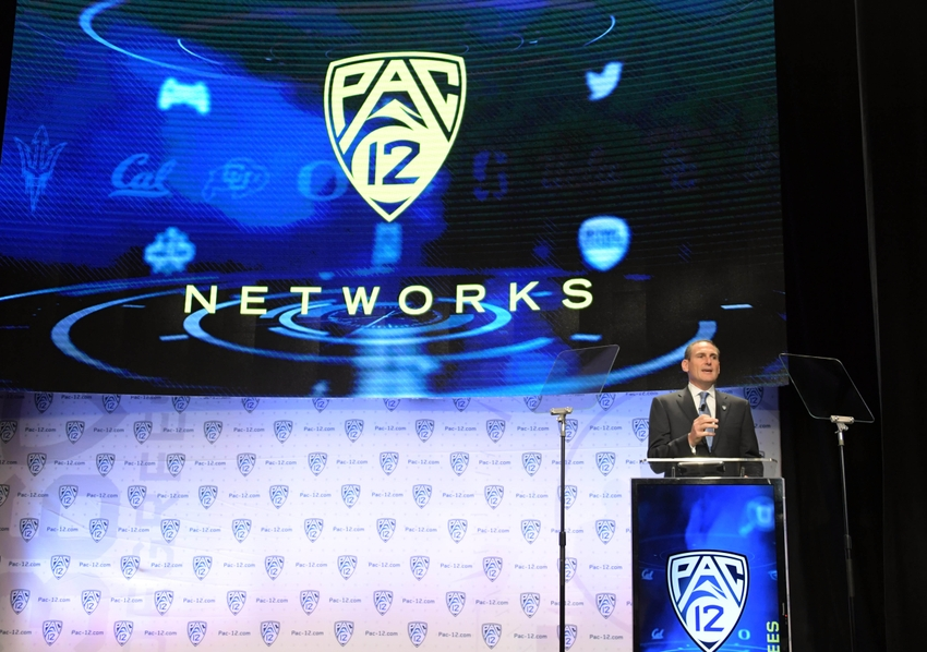 9383979-larry-scott-ncaa-football-pac-12-media-day