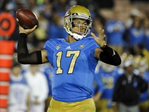 Oct 12, 2013; Pasadena, CA, USA; UCLA Bruins quarterback Brett Hundley (17) throws a pass during the fourth quarter against the California Golden Bears during the Bruins 37-10 win at Rose Bowl. Mandatory Credit: Robert Hanashiro-USA TODAY Sports