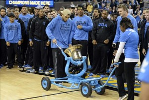 Dec 3, 2013; Los Angeles, CA, USA; (EDITORS NOTE: caption correction) UCLA Bruins player Tre Hale rings the victory bell in honor of their football victory over the Southern California Trojans at halftime of a basketball game between UCLA and the UC Santa Barbara Gauchos at Pauley Pavilion. Mandatory Credit: Richard Mackson-USA TODAY Sports