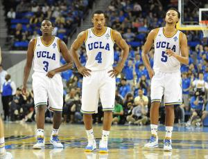 January 26, 2014; Los Angeles, CA, USA; UCLA Bruins guard Jordan Adams (3), guard Norman Powell (4) and guard/forward Kyle Anderson (5) during a stoppage in play against the California Golden Bears during the second half at Pauley Pavilion. Mandatory Credit: Gary A. Vasquez-USA TODAY Sports