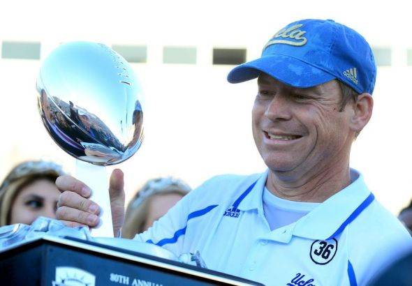 Dec 31, 2013; El Paso, TX, USA; UCLA Bruins head coach Jim Mora holds the 2013 Sun Bowl trophy after defeating Virginia Tech Hokies 42-12 at Sun Bowl Stadium. Mandatory Credit: Andrew Weber-USA TODAY Sports