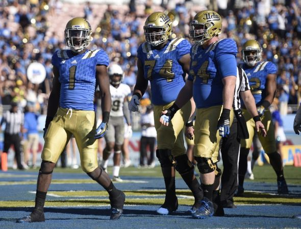 Oct 31, 2015; Pasadena, CA, USA; UCLA Bruins running back Soso Jamabo (1) celebrates with his team after running in for touchdown during the fourth quarter against the Colorado Buffaloes at Rose Bowl. The UCLA Bruins won 35-31. Mandatory Credit: Kelvin Kuo-USA TODAY Sports