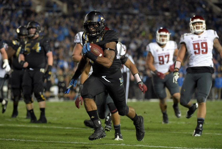 Nov 14, 2015; Pasadena, CA, USA; UCLA Bruins running back Nate Starks (23) scores on a 14-yard touchdown run in the second quarter against the Washington State Cougars in a NCAA football game at Rose Bowl. Mandatory Credit: Kirby Lee-USA TODAY Sports