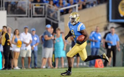 September 10, 2016; Pasadena, CA, USA; UCLA Bruins running back Soso Jamabo (9) runs the ball against the UNLV Rebels during the second half at Rose Bowl. Mandatory Credit: Gary A. Vasquez-USA TODAY Sports