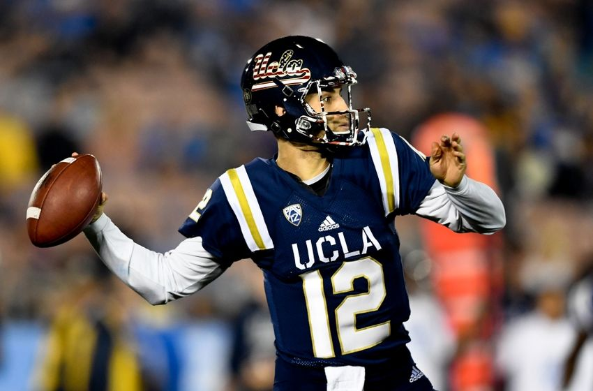 Nov 12, 2016; Pasadena, CA, USA; UCLA Bruins quarterback Mike Fafaul (12) passes against the Oregon State Beavers during the first half of a NCAA football game at Rose Bowl. Mandatory Credit: Kirby Lee-USA TODAY Sports