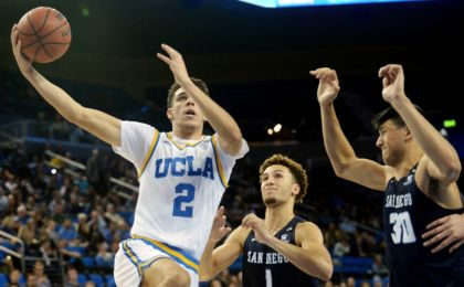 November 17, 2016; Los Angeles, CA, USA; UCLA Bruins guard Lonzo Ball (2) moves to the basket against San Diego Toreros guard Tyler Williams (1) and forward Frank Ryder (30) during the second half at Pauley Pavilion. Mandatory Credit: Gary A. Vasquez-USA TODAY Sports