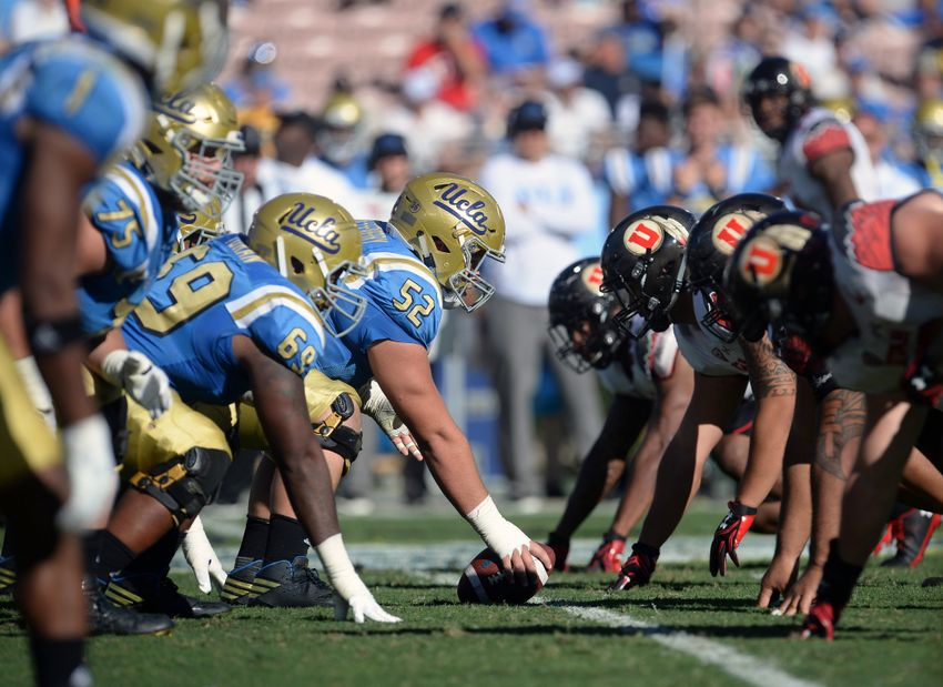 October 22, 2016; Pasadena, CA, USA; General view of UCLA Bruins offensive line against the Utah Utes defense before the snap during the second half at the Rose Bowl. Mandatory Credit: Gary A. Vasquez-USA TODAY Sports
