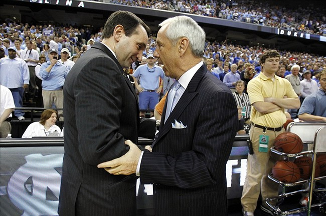 Mar 13, 2011; Greensboro, NC, USA; Duke Blue Devils head coach Mike Krzyzewski shakes hands with North Carolina Tar Heels head coach Roy Williams before the championship game of the 2011 ACC Tournament at the Greensboro Coliseum. Mandatory Credit: Bob Donnan-US PRESSWIRE