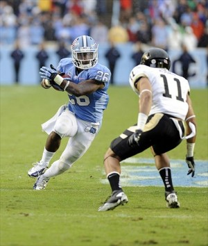 Sep 29, 2012; Chapel Hill, NC, USA; North Carolina Tar Heels running back Giovani Bernard (26) tries to get around Idaho Vandals safety Bradley Njoku (11) in the first half at Kenan Memorial Stadium. Mandatory Credit: Liz Condo-USA TODAY Sports