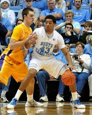 Dec 15, 2012; Chapel Hill, NC, USA; North Carolina Tar Heels forward James Michael McAdoo (43) backs toward the basket as East Carolina Pirates forward Marshall Guilmette (41) defends during the first half at the Dean E. Smith Center.  Mandatory Credit: Rob Kinnan-USA TODAY Sports